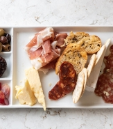 Daily Selection Of Cured Meta And Artisan Cheese, Onion Marmalade, Olives, Cornichon, French Bread, Stone Ground Mustard