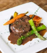Filet Mignon Madagascar, <em>6 oz Hand Cut Beef, Madagascar Peppercorn Sauce, White Cheddar Gratine, Grilled Asparagus, Rainbow Carrots</em>