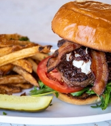 Icon Burger - 6oz Angus Beef, Onion Marmalade, Goat Cheese, Arugula, Heirloom Tomato, 17 Smoked Bacon, House Aioli, F2M Bun