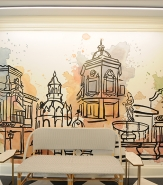 Beautifully impressionistic, hand-painted abstract murals throughout American Slang capture various elements of Kansas City's iconic Country Club Plaza.