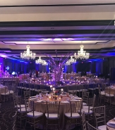 Dramatic lighting effects often add major ambience to night time wedding dinners.
