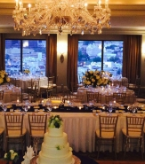 An InterContinental Kansas City rooftop wedding dinner includes the magnificent view of the Country Club Plaza.